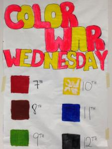 "The ""Color War Wednesday"" poster in the cafeteria, shown here ripped and damaged after 10th graders attempted to change their assigned color."