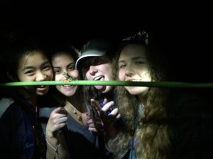 Sophomores pose with a red-eyed tree frog